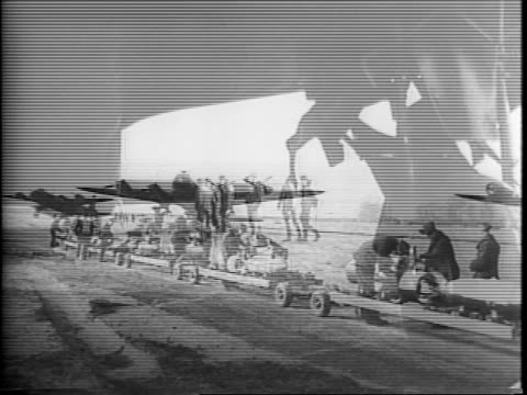 wide view of british royal air force stirling bombers lined up on a tarmac with troops walking inbetween them / view from top of stirling bomber of a... - スコットランド スターリング点の映像素材/bロール