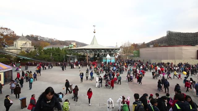 wide view of crowds at the everland resort operated by cheil industries inc in yongin gyeonggi province south korea on friday nov 14 visitors queue... - kyonggi do province stock videos and b-roll footage