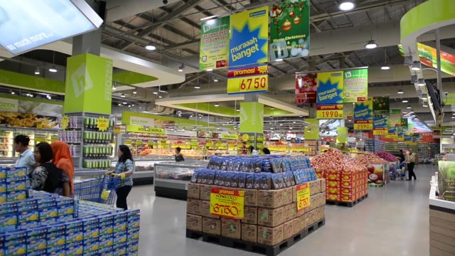 wide view of customers shopping inside a hypermart supermarket operated by pt matahari putra prima in jakarta indonesia on friday jan 23 customers... - cart stock videos and b-roll footage