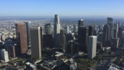 AERIAL: Wide view of Downtown Los Angeles, California Skyline at beautiful blue sky and sunny day [4K]