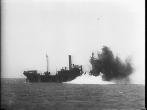 wide view of ocean / ship with bomb exploding in front / ship slowly sinking / ship being bombed / ship bombing survivors speaking to camera while... - sink stock videos and b-roll footage