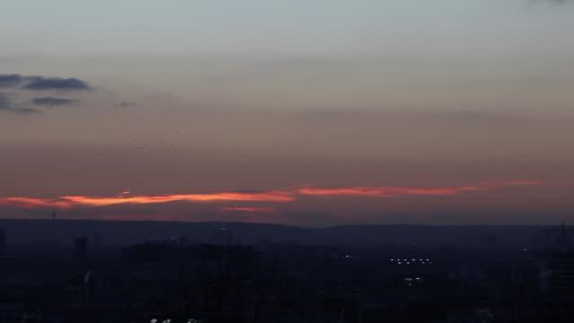 vídeos de stock, filmes e b-roll de wide view of paris after sunset - wide