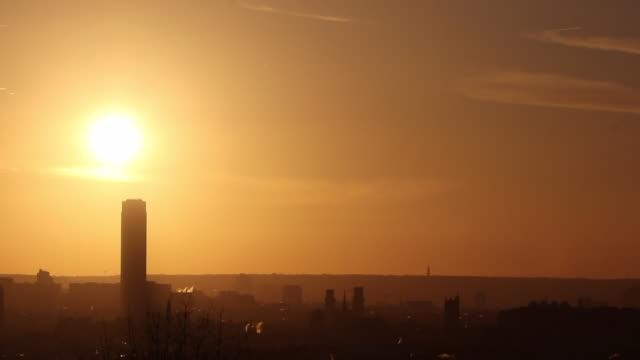 vidéos et rushes de wide view of paris at sunset - large