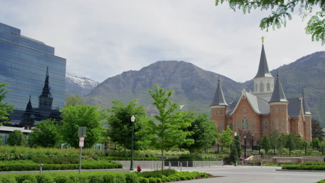 wide view of provo city center temple reflecting in nu skin building - mormonism stock videos & royalty-free footage