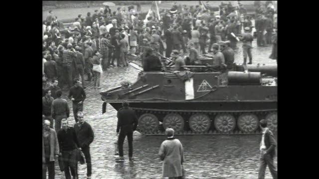 wide view of tanks chasing away crowds of people at old town square during the soviet invasion of czechoslovakia moving tank consumed by cloud of gas... - prague old town square stock videos & royalty-free footage