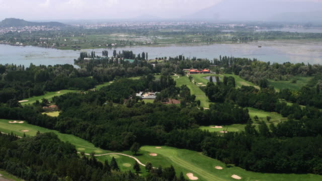 a wide view of the dal lake and the srinagar golf course with the city in the background, from high on the neighbouring himalayan mountains - wide shot stock videos & royalty-free footage