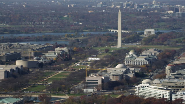 wide view of the national mall from capitol building to lincoln memorial. airplane flies from right to left behind washington monument. shot in november 2011. - artbeats stock videos & royalty-free footage