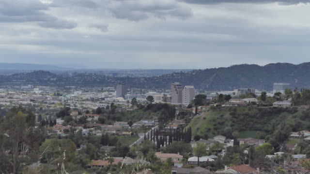 wide view of the san fernando valley and the hollywood hills and downtown glendale zoom in on tall buildings southern california los angeles - cloudscape stock videos & royalty-free footage