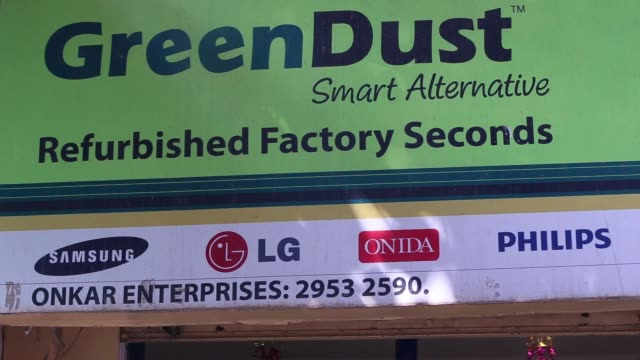 vídeos y material grabado en eventos de stock de wide view of the storefront of greendust, a unit of reverse logistics co, in the neb serai area of new delhi, india, greendust logo on storefront,... - pantalla de cristal líquido