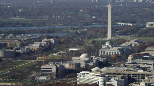 wide view of the washington monument with national mall in foreground, lincoln memorial and arlington memorial bridge over potomac river in background. airplane flies right to left behind monument. shot in november 2011. - artbeats stock videos & royalty-free footage