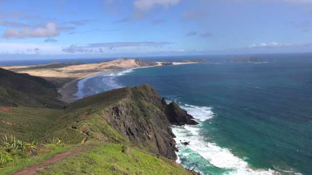 wide view overlooking cape reinga lighthouse and it's surrounds, showing where the tasman sea and pacific ocean meet to create an area of turbulent waters, new zealand, north island. - north island new zealand stock videos & royalty-free footage