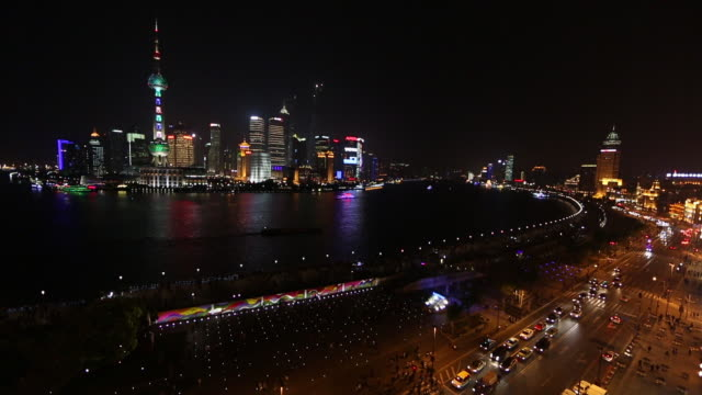 Wide view overlooking the Huangpu River toward many towers in Shanghai, China.