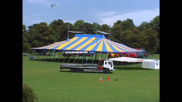wide views of a large marquee or tent that has been constructed in advance of pride in preston park, brighton, uk; 2000. - tent stock videos & royalty-free footage
