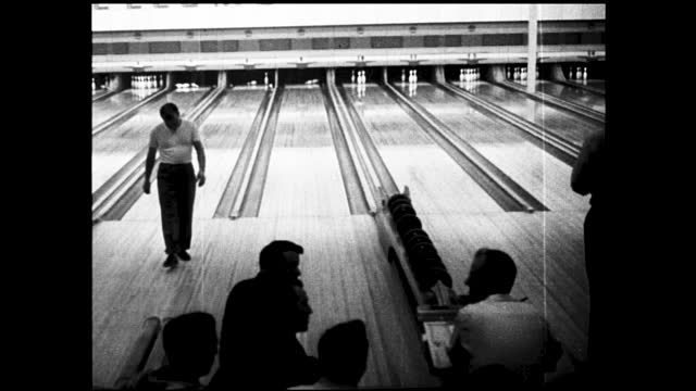 vídeos y material grabado en eventos de stock de wide views of people bowling at busy bowling alley - 1940 1949