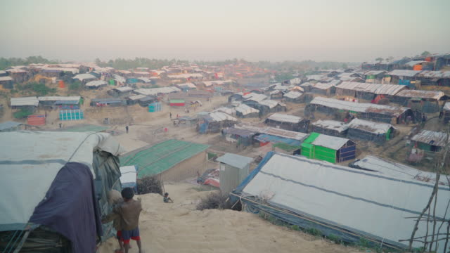 Wide vista of Kutupalong refugee camp in Bangladesh movement down stairs Fleeing persecution by the Myanmar government and Rakhine vigilantes the...