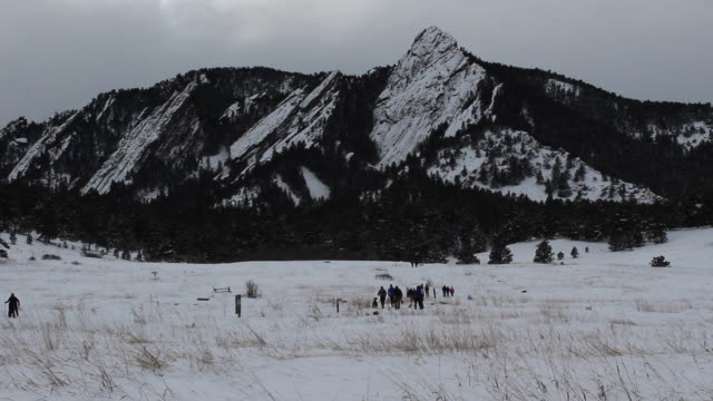 Wide winter shot of pedestrians and hikers at Chautauqua Park