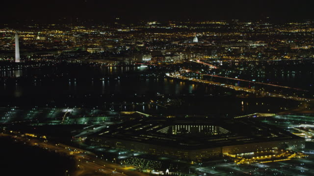 widening night view of the pentagon with potomac river and washington dc in background. shot in 2011. - the pentagon stock videos and b-roll footage