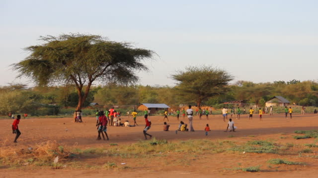 Wideshot of boys playing soccer
