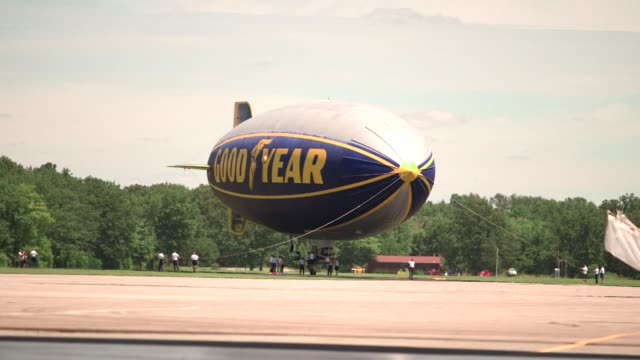 Wideshots of a Goodyear Blimp groundcrew preparing a Goodyear blimp for flight outside of their Airdock in Akron Ohio A groundcrew maneuvers a...