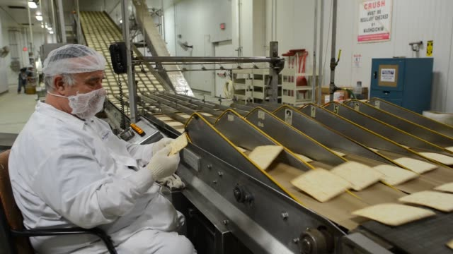 Wideshots of a large industrial biscuit and cracker oven at the Manischewitz Co factory in Newark New Jersey US A Mashgiach a Jew who supervises the...