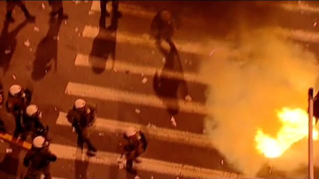 widespread disorder following new spending cuts t12021219 athens high angle view explosions in front of riot police sot - ファイサル・イスラム点の映像素材/bロール