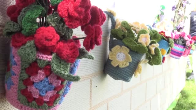 a widow from gloucester has created a 'knitted garden' in memory of her husband and in tribute to the hospice which cared for him clare young lost... - widow stock videos and b-roll footage