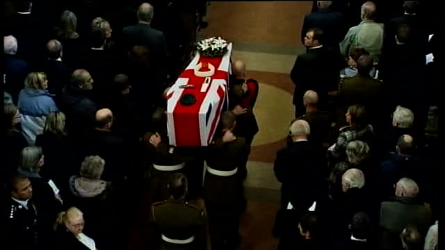 widow of bomb disposal expert olaf schmid speaks out following inquest lib ext **music heard sot** military pallbearers carrying flagdraped coffin of... - widow stock videos & royalty-free footage