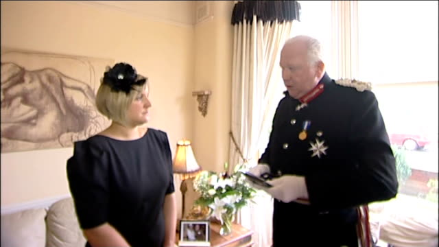 widow of cpl loren marltonthomas awarded elizabeth cross england lancashire lytham st anne's int nicola marltonthomas standing beside lord... - widow stock videos and b-roll footage