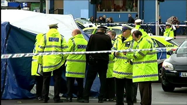 widow of cyclist calls elephant and castle roundabout 'deathtrap' t13051418 / tx police officers standing next to forensic tent at scene where... - widow stock videos & royalty-free footage