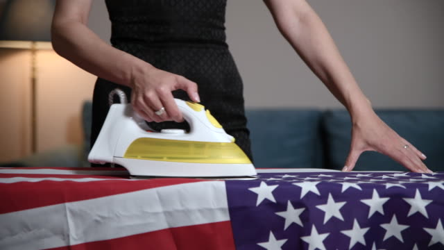 widow of fallen soldier ironing americain flag - us memorial day stock videos & royalty-free footage