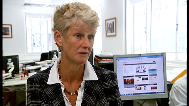 stockvideo's en b-roll-footage met widow of man killed at nightclub event launches antiglass bottle campaign brigid simmonds sitting at desk 'preventattiv emeasures' document brigid... - weduwe