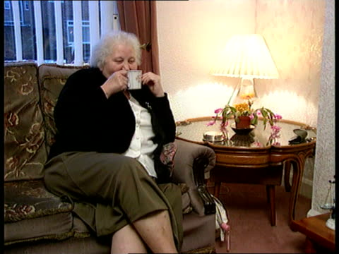 vídeos de stock, filmes e b-roll de widow wins share in pools win; england: co durham: cms ivy richardson as sat in chair drinking cup of coffee - widow