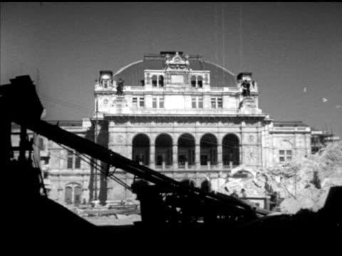 wiener staatsoper building under repair, men working inside scaffolding, carrying wood, male w/ large block of stone, stone cutter trimming edge of... - vienna austria stock videos & royalty-free footage