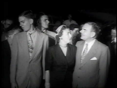 vídeos de stock, filmes e b-roll de wife and sons greeting new york governor dewey on his return to home from a trip to the far east / new york city, new york, united states - 1951