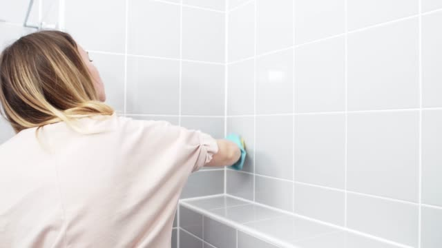 wife cleaning bathroom walls - washing stock videos & royalty-free footage