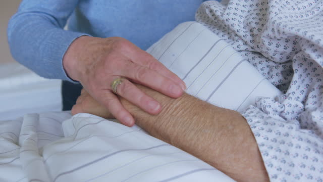 wife comforting his hospitalized husband - stroking stock videos & royalty-free footage