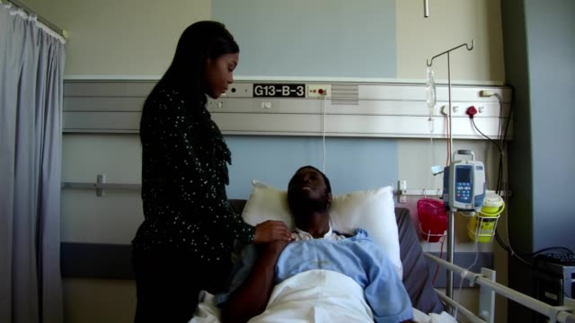 wife consoling her husband in hospital - ward stock videos & royalty-free footage