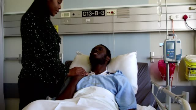 wife consoling her husband in hospital - visit stock videos & royalty-free footage