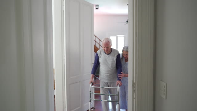 wife helping her senior husband with mobility walker - walking frame stock videos & royalty-free footage
