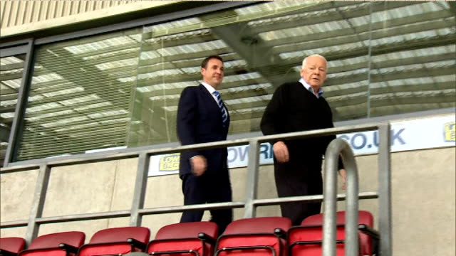 wigan athletic sponsor pulls out over malky mackay signing england greater manchester wigan malky mackay through stands with wigan athletic owner... - neckwear stock videos and b-roll footage