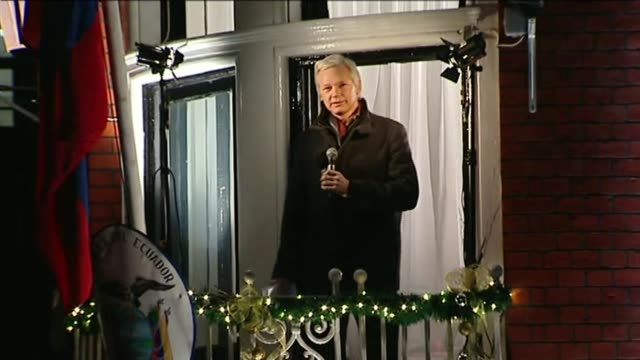 assange publishes new book the wikileaks files ****flash assange onto balcony at the ecuadorian embassy where he is claiming political asylum to... - address book stock videos & royalty-free footage