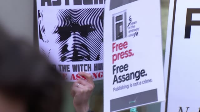 wikileaks founder julian assange arrested at the ecuador embassy and faces us extradition england london westminster ext supporters of wikileaks... - westwood stock-videos und b-roll-filmmaterial