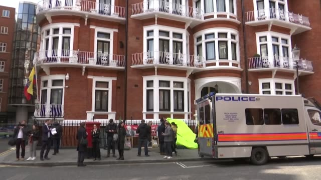 wikileaks founder julian assange arrested at the ecuador embassy and faces us extradition england london ext protesters and police van outside the... - arrest stock videos & royalty-free footage