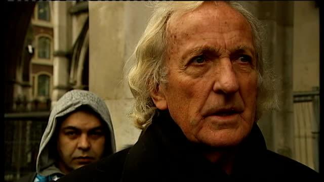 wikileaks founder julian assange released from prison on bail: john pilger and tariq ali interviewed; pilger interview sot - most people were pleased... - john pilger stock videos & royalty-free footage