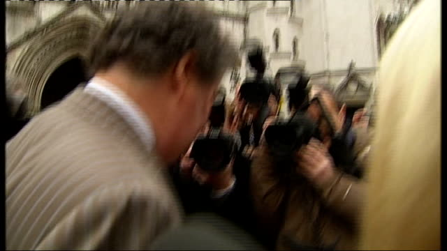 wikileaks founder julian assange released from prison on bail: mark stephens press conference; england: london: high court: ext - shaky camera stock videos & royalty-free footage