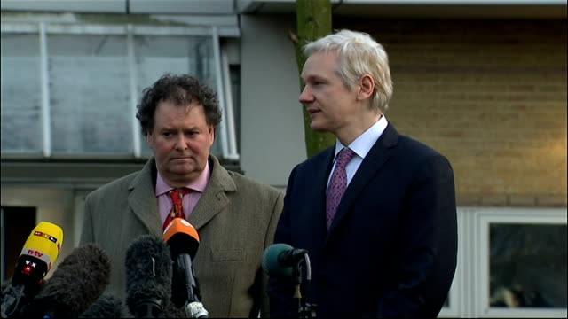 wikileaks founder speaks to press outside extradition hearing; england: london: belmarsh magistrates' court: ext julian assange along from court to... - orthographic symbol stock videos & royalty-free footage