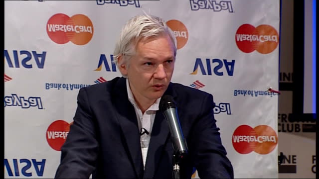 wikileaks suspends publication of classified files due to 'financial blockade': julian assange press conference; julian assange press conference sot... - human arm stock videos & royalty-free footage