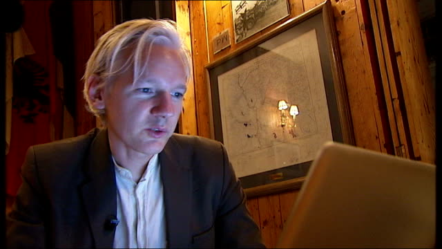 wikileaks website reveals 90,000 classified documents relating to the conflict in afghanistan; close up of assange general view of assange seated at... - editorial stock videos & royalty-free footage