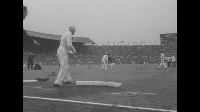 wilbur thompson, american track and field athlete, at the summer olympics at wembley stadium in london / french athlete micheline ostermeyer of... - shot put stock videos & royalty-free footage