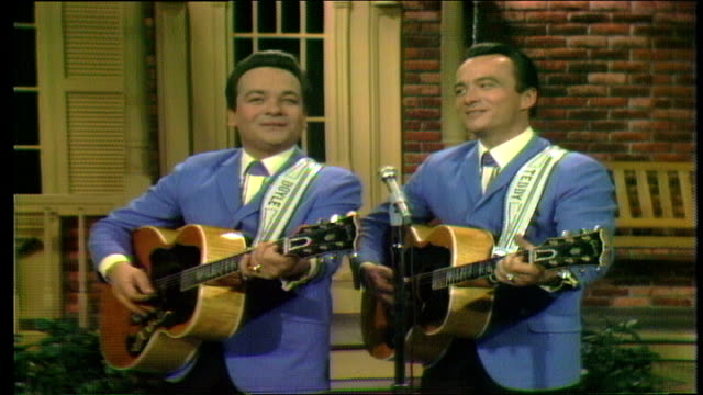 """wilburn brothers show"" opening sequence. the wilburn brothers perform ""trouble's back in town"" with band. announcer introduces show, regulars... - country and western stock videos & royalty-free footage"
